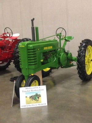Mishicot FFA members recently fixed up an old John Deere tractor.
