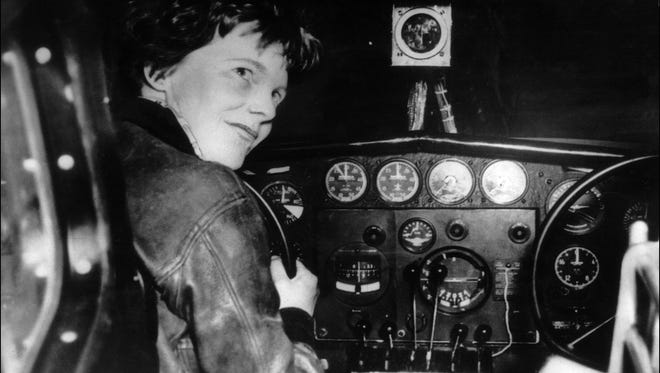 An undated 1930's file photo shows US aviator Amelia Earhart at the controls of an aircraft in Essonne, France.