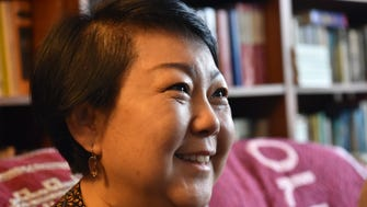 """Stephanie Young watches Korean news about the leaders of North and South Korea who vowed Friday to rid the Korean Peninsula of nuclear weapons and start a """"new era of peace,"""". Stephanie mother escaped North Korea when she was only 13 years old."""