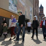 Dr. Jennifer Davis, second adult from left, walks with a group during Adena Health System's first Walk with a Doc March 30 in downtown Chillicothe. The event included a Panera Bread lunch, a presentation about starting a fitness program and a walk around downtown Chillicothe. Walk with a Doc will be held one Wednesday and one Saturday a month through December.