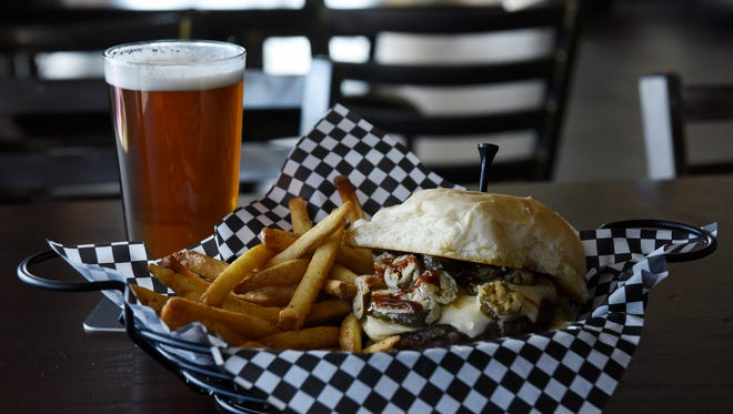 Smokey Willow Burger with pepper jack cheese, bacon, BBQ sauce and fried jalapenos paired with a Fernson Brewing IPA at The Willows restaurant at Willow Run Golf Course, April 11, 2016.