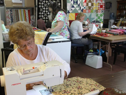 Pataskala-area resident Sharon White participates in a 31-hour pillowcase sewing challenge at Calico Cupboard Quilt Shop in Pataskala.