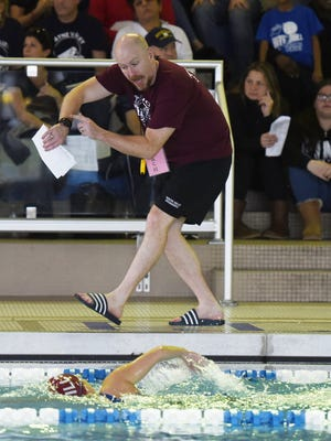 Wayne Hills swimming coach Mike Shale urges his swimmer in the 500 Yard Freestyle by making them aware of their time.