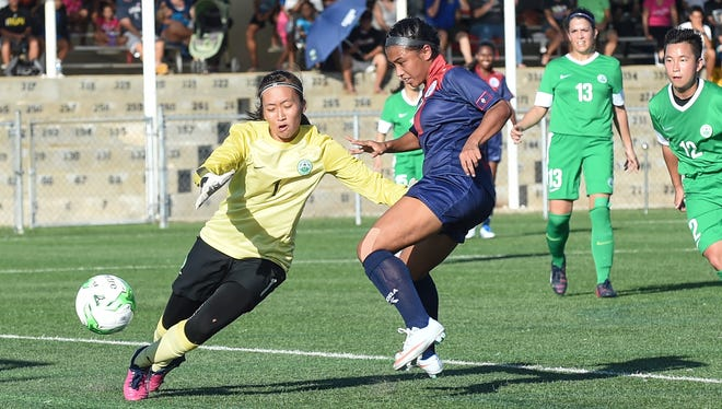 In this June 29 file photo, Skyylerblu Johnson of the Masakåda scores a goal against Macau-China in an EAFF E-1 Football Championship Round 1 game at the Guam Football Association National Training Center.