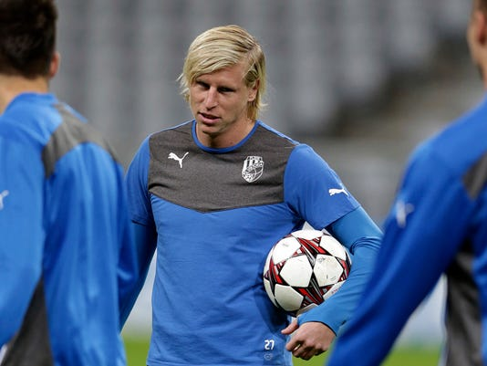 """FILE - In this Tuesday, Oct. 22, 2013 file photo, Plzen's Frantisek Rajtoral holds a ball during a training session in Munich, southern Germany. Former Czech Republic defender Frantisek Rajtoral, who won the domestic league title four times before joining Turkish club Gaziantepspor, died on Sunday April 23, 2017. He was 31. The Czech football federation said in a statement that Rajtoral had """"committed suicide in Turkey."""" (AP Photo/Matthias Schrader, File)"""