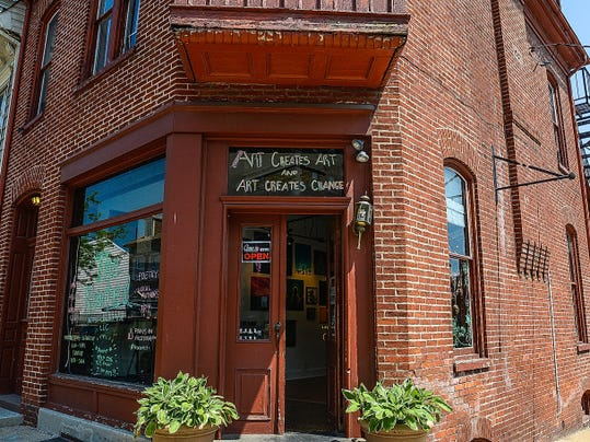 A group of local artists, including Dustin Nispel and Jessica Flynn, have opened The Rooted Artist Collective at 101 N. Newberry Street.  The collective features art of varying styles from photography and painting to hand-crafted jewelry and books by local writers. Thursday May 7, 2015. John A. Pavoncello - jpavoncello@yorkdispatch.com