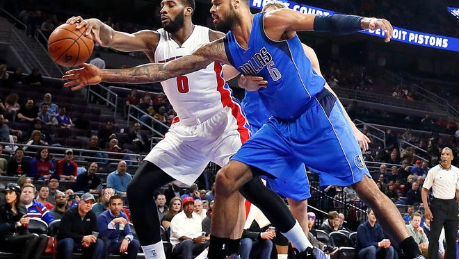 Pistons center Andre Drummond and Mavericks center Tyson Chandler vie for a loose ball during the first half of the Pistons' 117-106 loss Wednesday at the Palace.