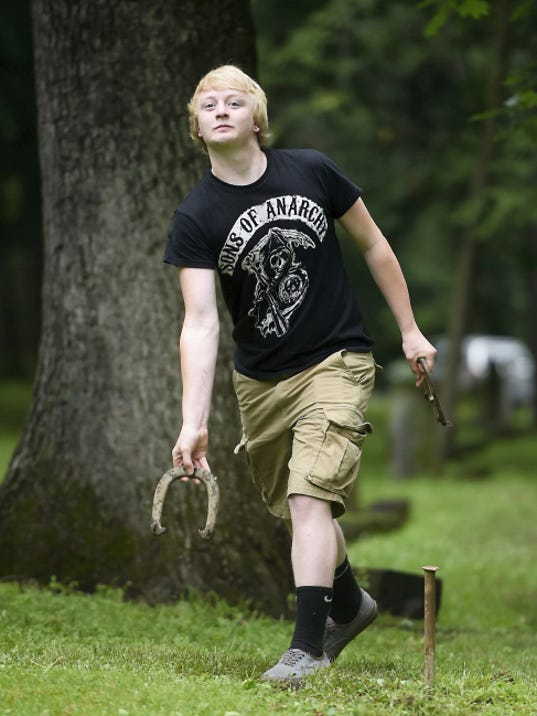 Austin Swarner of Quarryville prepares to let loose a horseshoe during an annual holiday gathering of the Swanger family of Annville and the Wolfe family of Lebanon Saturday at Coleman Memorial Park.