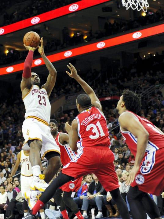 Cleveland's LeBron James (23) shoots the ball over Philadelphia's Hollis Thompson during the second half of Monday's game in Philadelphia. The Cavaliers won, 107-100, and James became the youngest player to reach 25,000 points.