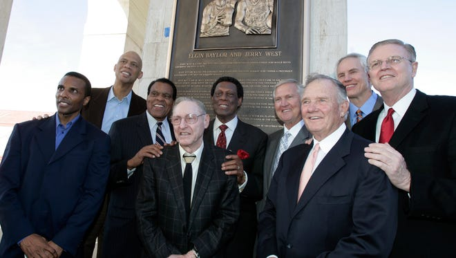 Former Los Angeles Lakers gather for a group portrait at a ceremony honoring Jerry West and Elgin Baylo rin 2009. From left are Ronnie Lester, Kareem Abdul-Jabbar, Tommy Hawkins, coach Bill Sharman, Baylor, West, coach Bill Bertka, Mitch Kupchak and Keith Erickson.