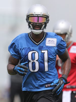 Detroit Lions wide receiver Calvin Johnson goes through passing drills during practice on June 17, 2015 at the Lions Allen Park practice facility. Johnson has returned to Twitter after a lengthy hiatus.