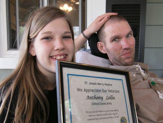 Eva Lollio, 13, holds a certificate of appreciation