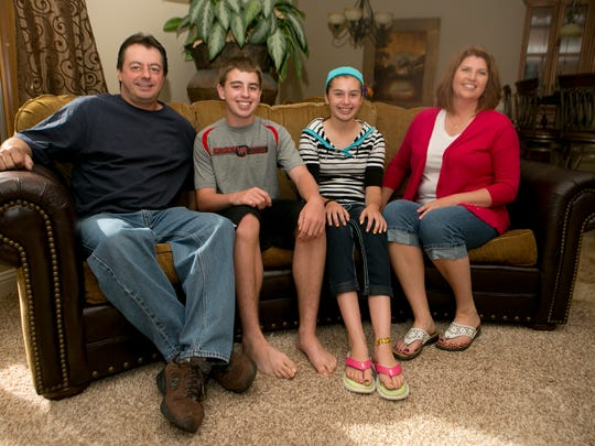 Debby Wallner, right, with her family, from left, husband Tim, son Andy, 15, and daughter Beth 13, at her home in Wisconsin Rapids.
