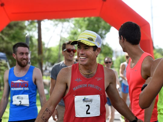 """Brian Solomon is all smiles after his team, the """"Runny Bums,"""" won the Reno Tahoe Odyssey race at Idlewild Park in Reno on May 30, 2015. The RTO is a 178 mile relay race that starts and ends in Reno and goes all the way around Lake Tahoe featuring teams of 12 runners."""