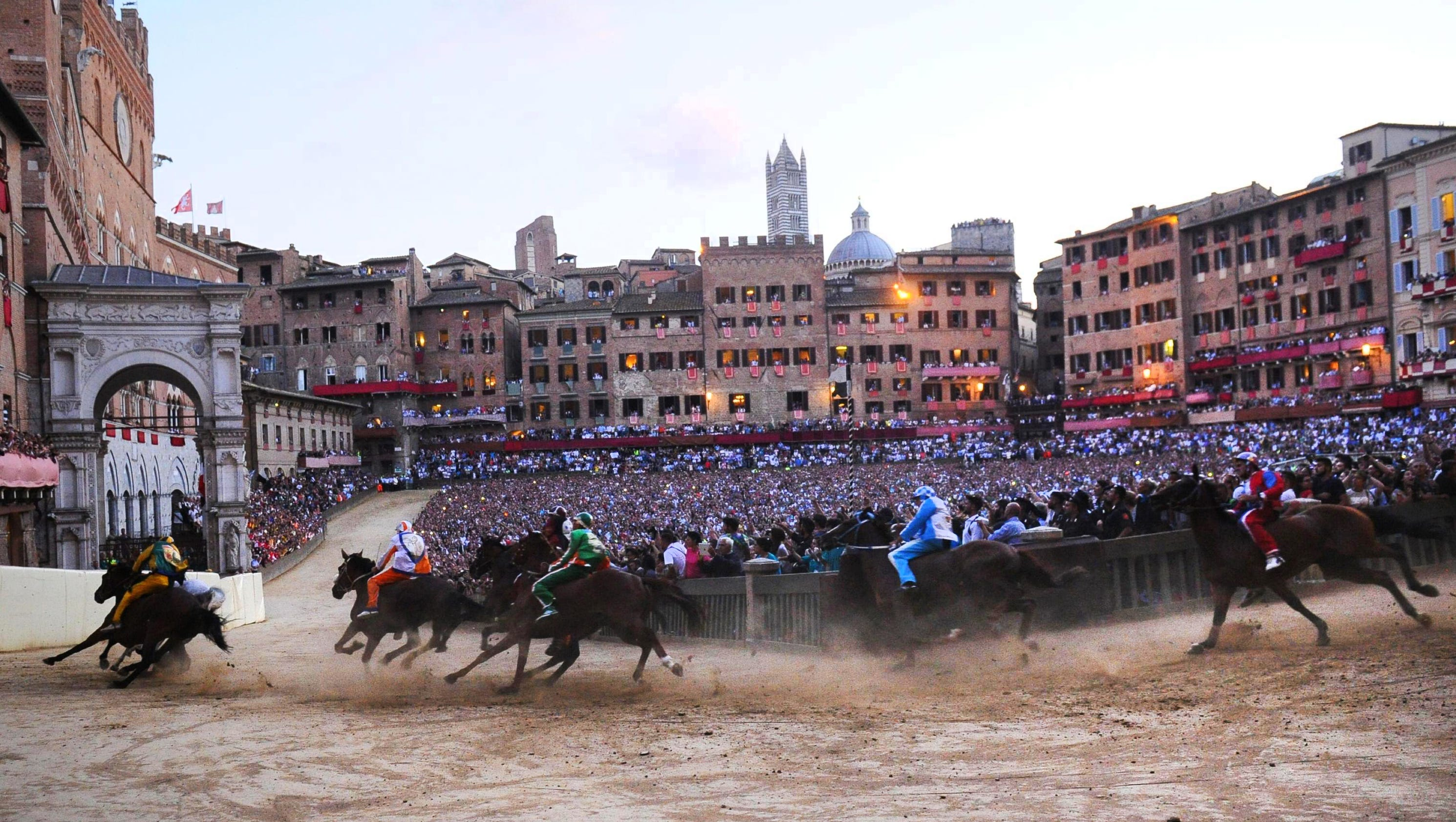The ancient tradition of the palio di siena horse races for Italian culture