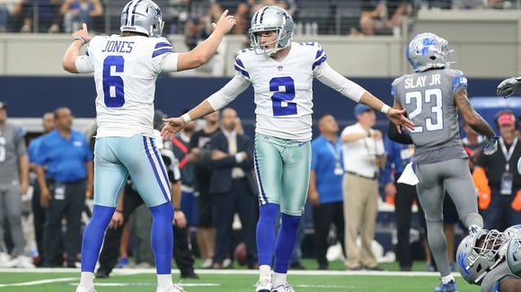 Sep 30, 2018; Arlington, TX, USA; Dallas Cowboys kicker Brett Maher (2) celebrates his game winning field goal in the fourth quarter with holder Chris Jones (6) against the Detroit Lions at AT&T Stadium. Mandatory Credit: Matthew Emmons-USA TODAY Sports