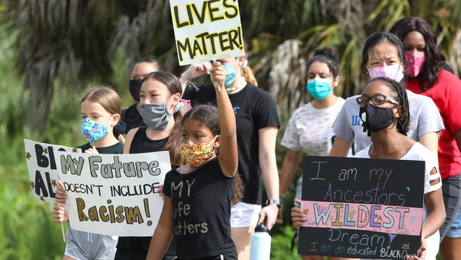 Children lead the way as they and their parents take part in a march organized for young people to show their solidarity with the Black Lives Matter movement, at Depot Park in Gainesville on Saturday morning.