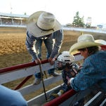 Cowboys get ready to ride in the bull riding competition at the St. Paul Rodeo on Tuesday, June 30, 2015.