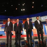 Presidential candidates Rick Santorum, Chris Christie, Mike Huckabee and Bobby Jindal take the stage during the undercard debate in Milwaukee on Nov. 10, 2015.