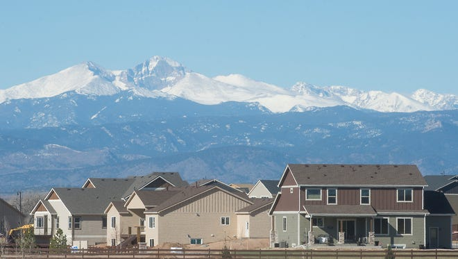A snow-capped Front Range rises above Northern Colorado on Saturday. Snow totals for most of the Front Range, including the South Platte River basin, are over 100 percent of yearly averages.