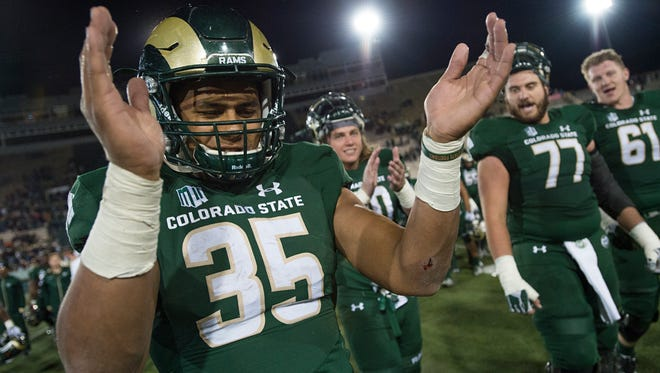 CSU running back Izzy Matthews celebrates a 31-24 win over Utah State last Saturday night that put the Rams right back in the thick of the race for a fourth consecutive bowl berth.