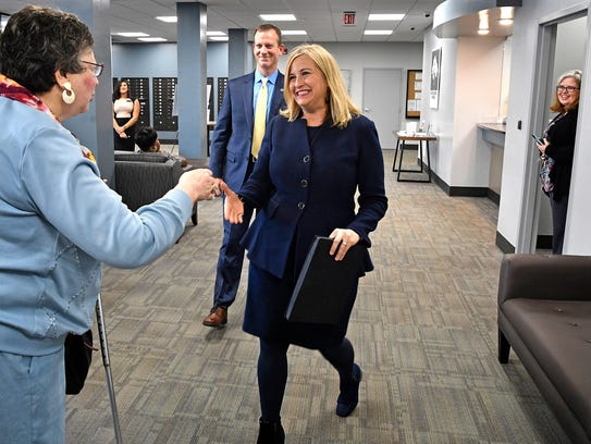 Mayor Megan Barry shakes hands with a resident as she