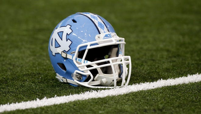 A North Carolina Tar Heels helmet on the field prior to the 2016 Chick-Fil-A Kickoff game against the Georgia Bulldogs at Georgia Dome.