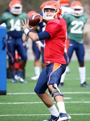 UTEP quarterback Zack Greenlee takes his team through practice Tuesday morning as the team prepares for their season opener against NMSU on Saturday in the Sun Bowl.