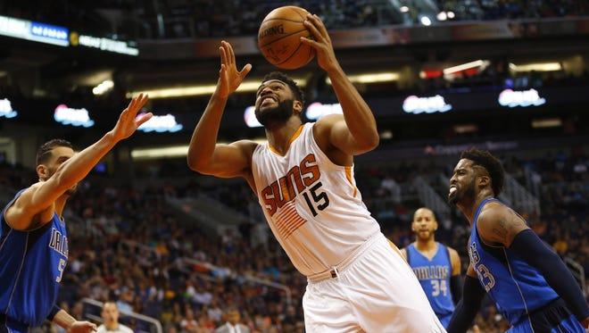 Phoenix Suns forward Alan Williams (15) drives past Dallas Mavericks center Salah Mejri (50) and forward Nerlens Noel (3) during the second quarter at Talking Stick Resort Arena in Phoenix, Ariz. April 9, 2017.
