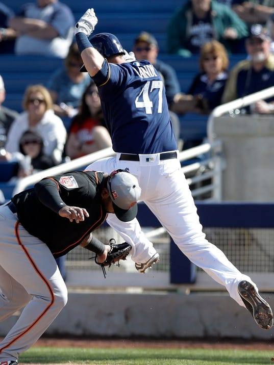 Milwaukee Brewers' Jett Bandy (47) is tagged by San Francisco Giants first baseman Pablo Sandoval during the fourth inning of a spring training baseball game, Wednesday, Feb. 28, 2018, in Maryvale, Ariz. (AP Photo/Carlos Osorio)