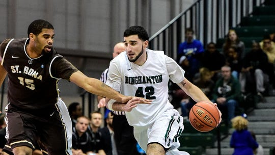 Binghamton forward Willie Rodriguez dribbles pas a