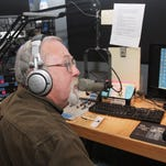 Ken Cartwright hosts a radio show in 2012.