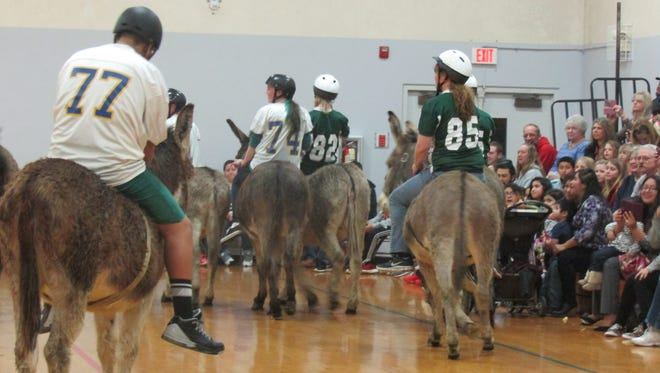 Eighth graders at Gervais Middle School, in white, played donkey basketball against teachers and staff on Thursday, Jan. 21, 2016. The game was a fundraiser for the school.