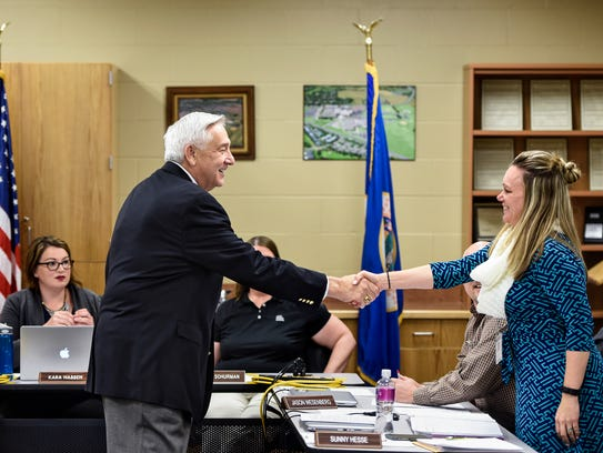 Possible acting superintendent John Thein shakes hands