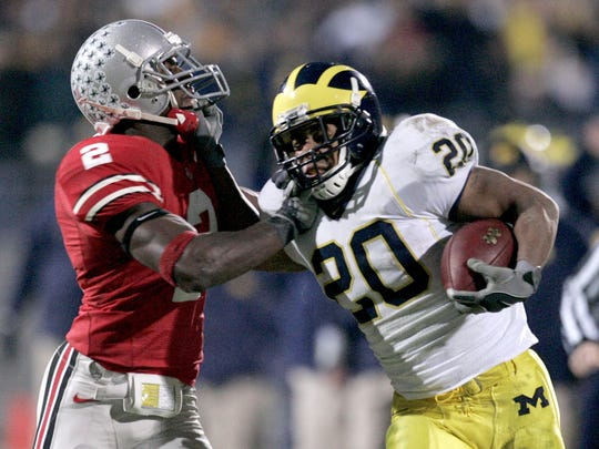 Michigan's Mike Hart gets in a grabbing match with Ohio State's Malcolm Jenkins after a long Hart run on Saturday, Nov. 18, 2006 in Columbus, Ohio.