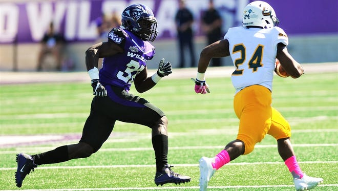 ACU's Bolu Onifade, left, chases down Southeastern Louisiana running back Darren Johnson during their Southland Conference game Saturday, Oct. 21, 2017 at Wildcat Stadium. The Lions beat ACU 56-21.