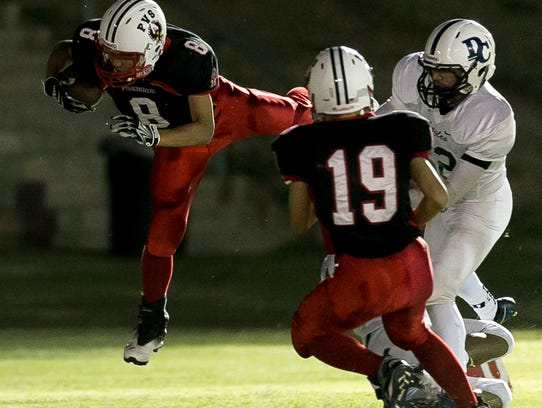 Gavin Li (No. 8) of Palm Valley gets airborne as he