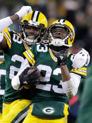 Green Bay Packers cornerback Damarious Randall celebrates a late second quarter interception with Josh Hawkins against the Seattle Seahawks at Lambeau Field.