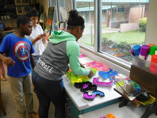 Ruediger fourth-graders retrieve their letters for