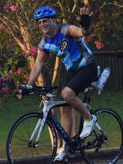 Louis Guidry waves as he heads out early Monday morning on a social ride with other cyclists.