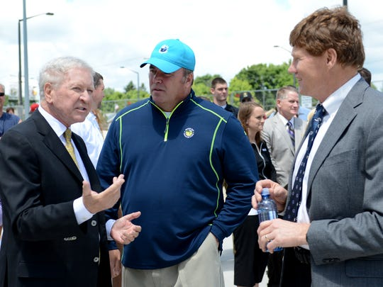 Former Green Bay Packers president and CEO Bob Harlan, left, talks with Packers coach Mike McCarthy, center, and Packers president and CEO Mark Murphy, during Wednesday's re-dedication of Harlan Plaza at Lambeau Field.