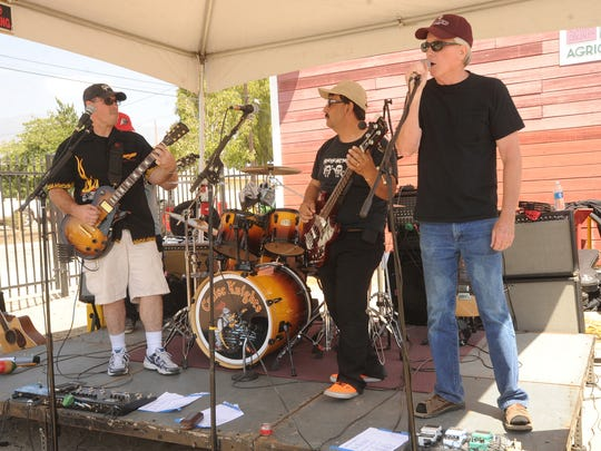 The Cruise Knights band, made up of Jerry Byron (from left) Carlos Juarez and Paul Skeels, as well as Wes Easley and Del Sawyer, entertain the crowd at the Agriculture Museum after the Santa Paula Labor Day Parade.