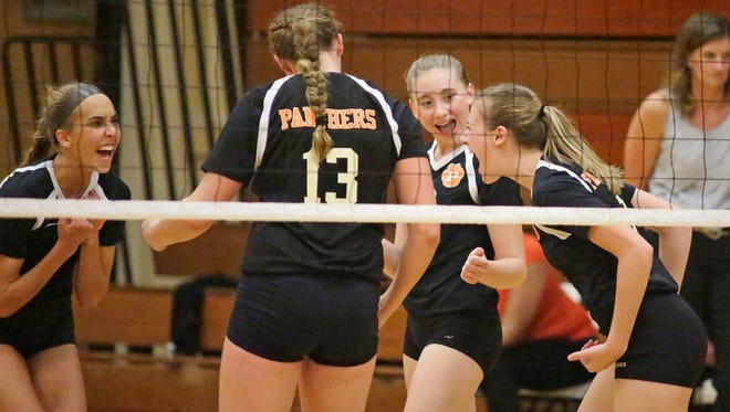 Plymouth celebrates a point against Winneconne Thursday September 22, 2016 at Plymouth.