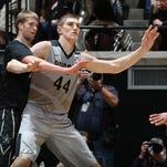 Purdue Boilermakers center Isaac Haas (44) posts up Vanderbilt Commodores center Josh Henderson (40) at Mackey Arena. Purdue defeat Vanderbilt 68-55.