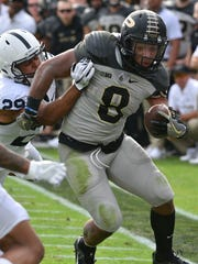 Purdue running back Markell Jones tries to elude a