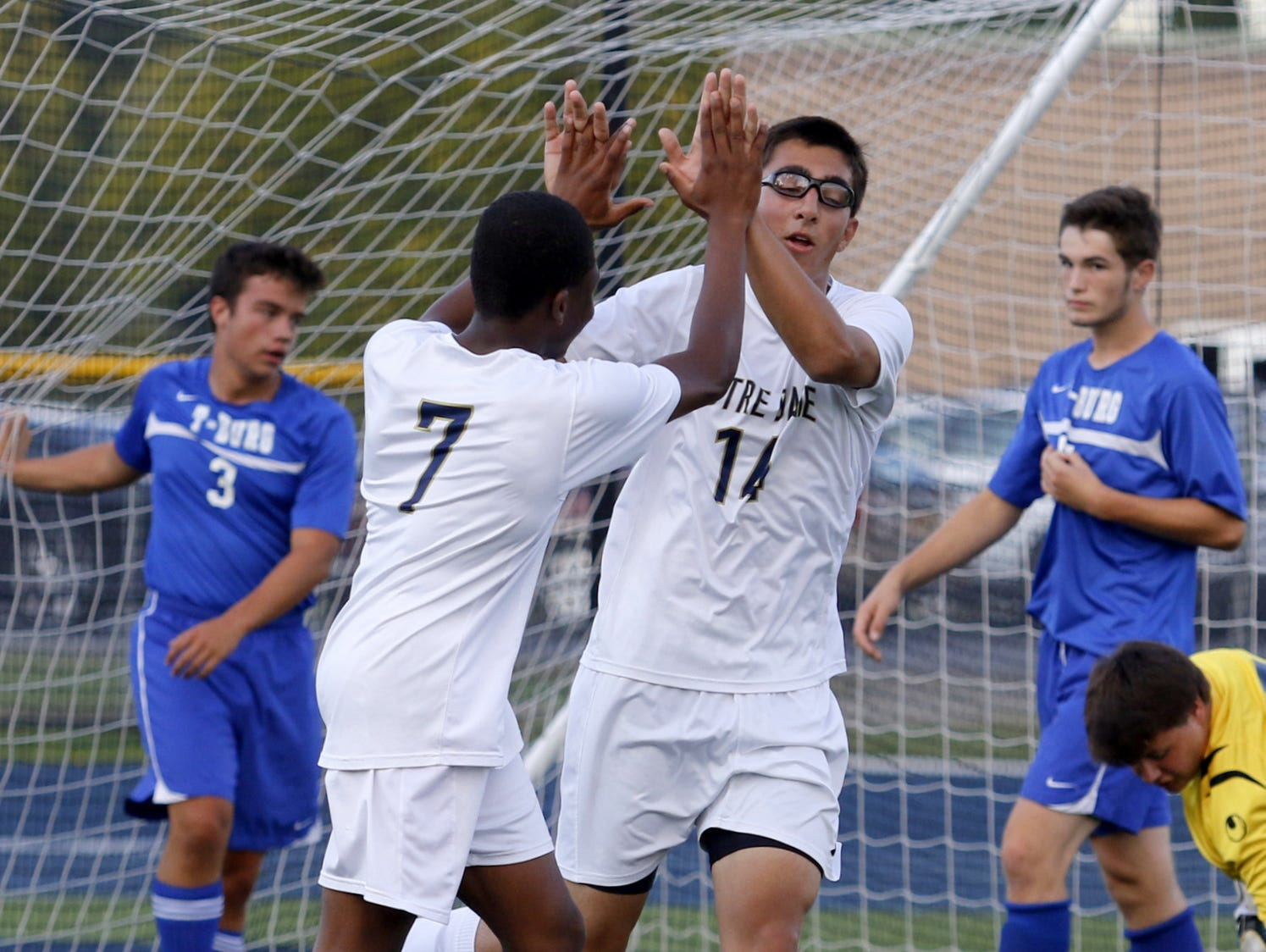 Notre Dame's Rocco Coulibaly (7) and Aidan Sharma celebrate a goal against Trumansburg earlier this season.