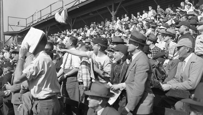Fans get into the action at Borchert Field during the 1952 season opener between the Milwaukee Brewers and the Minneapolis Millers on April 16, 1952. The game was the last opening day at the Milwaukee ballpark.
