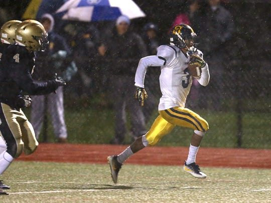 Spencerport running back Alton Jones gets outside and scores on a long run against Brighton.