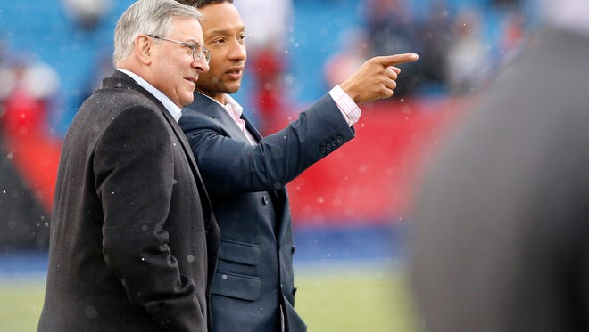 Buffalo Bills owner Terry Pegula, left, speaks with general manager Doug Whaley on the field before the game against the Cincinnati Bengals at Ralph Wilson Stadium last Sunday. Whaley spoke to reporters in London on Friday.