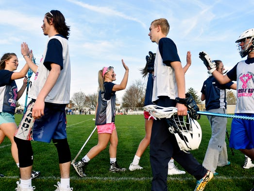 West York boys' and girls' lacrosse players greet each